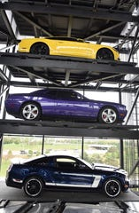 A view of cars from inside the eight-story glass Carvana tower in Novi.