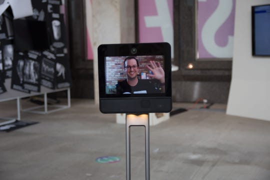 "In the exhibition ""Future Present"" from Science Gallery Detroit ""telepresence"" robots staffed by off-site mediators, in this case Patrick Vaughn, can follow you around and engage you in conversation."