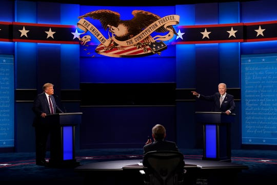 President Donald Trump, left, Democratic presidential candidate former Vice President Joe Biden, right, speaking during the first presidential debate with moderator Chris Wallace of Fox News, center, Tuesday, Sept. 29, 2020, at Case Western University and Cleveland Clinic, in Cleveland, Ohio.