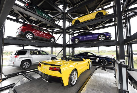 A view of cars from inside the eight-story glass and steel Carvana tower in Novi.