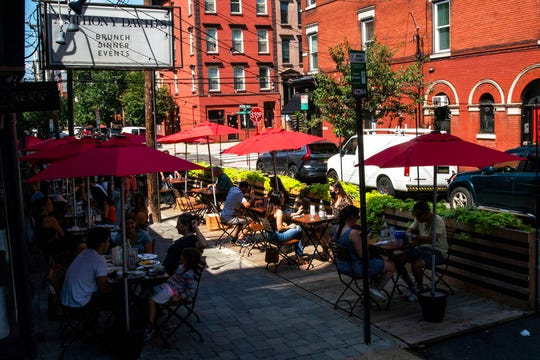 People eat outside at a local restaurant during lunch on Friday, Sept. 4, 2020, in Hoboken, N.J.