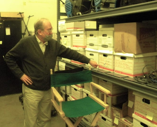 Producer Frank Boring looks at some of the dozens of boxes of video and film his team cataloged Tuesday, Sept. 29, 2020, at the Clark building while working on a documentary on Colorado State University's 150-year history.