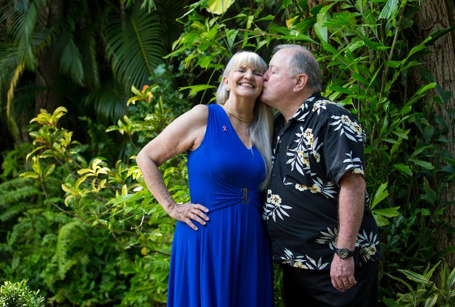 Judy Frank gets a kiss from her husband Bill on the patio at The Veranda in Fort Myers on Wednesday, Sept. 30, 2020. They were married at The Veranda in 2007, and Judy had her breast cancer surgery on their anniversary this year.