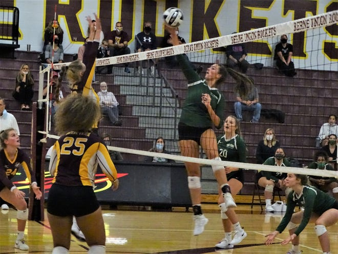 Berne Union's Bella Kline goes for a block at the net against Fisher Catholic's Averie Bruce during thier Mid-State League-Cardinal Division game Tuesday night. The Rockets won in four sets.