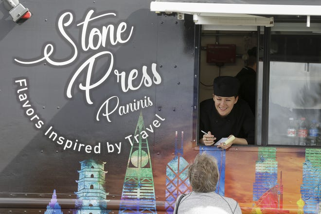 Gabrielle Falkey takes a customer's order from Stone Press Food Truck on Wednesday, Sept. 30, 2020, at Forward Bank in Marshfield, Wis. The food truck held its grand opening Wednesday.