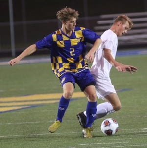 Wooster's Jacob Kane successful challenges during the Generals' home win over Lexington.