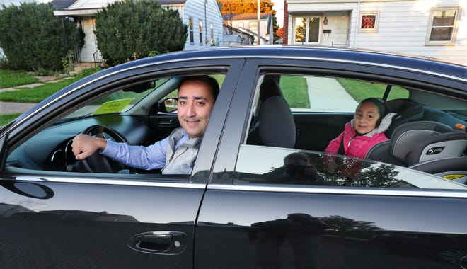 Alex Zamora Jr. gets his daughter Camila Zamora age 6, to first grade in person classes at Bruce Guadalupe Community School via car from their southside Milwaukee home.