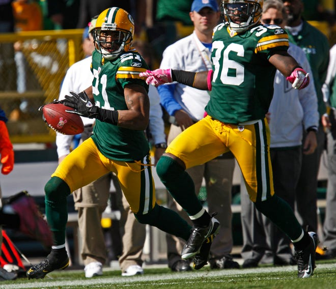 Charles Woodson returns an interception for a touchdown against the Detroit Lions at Lambeau Field, Sunday, October 3, 2010.