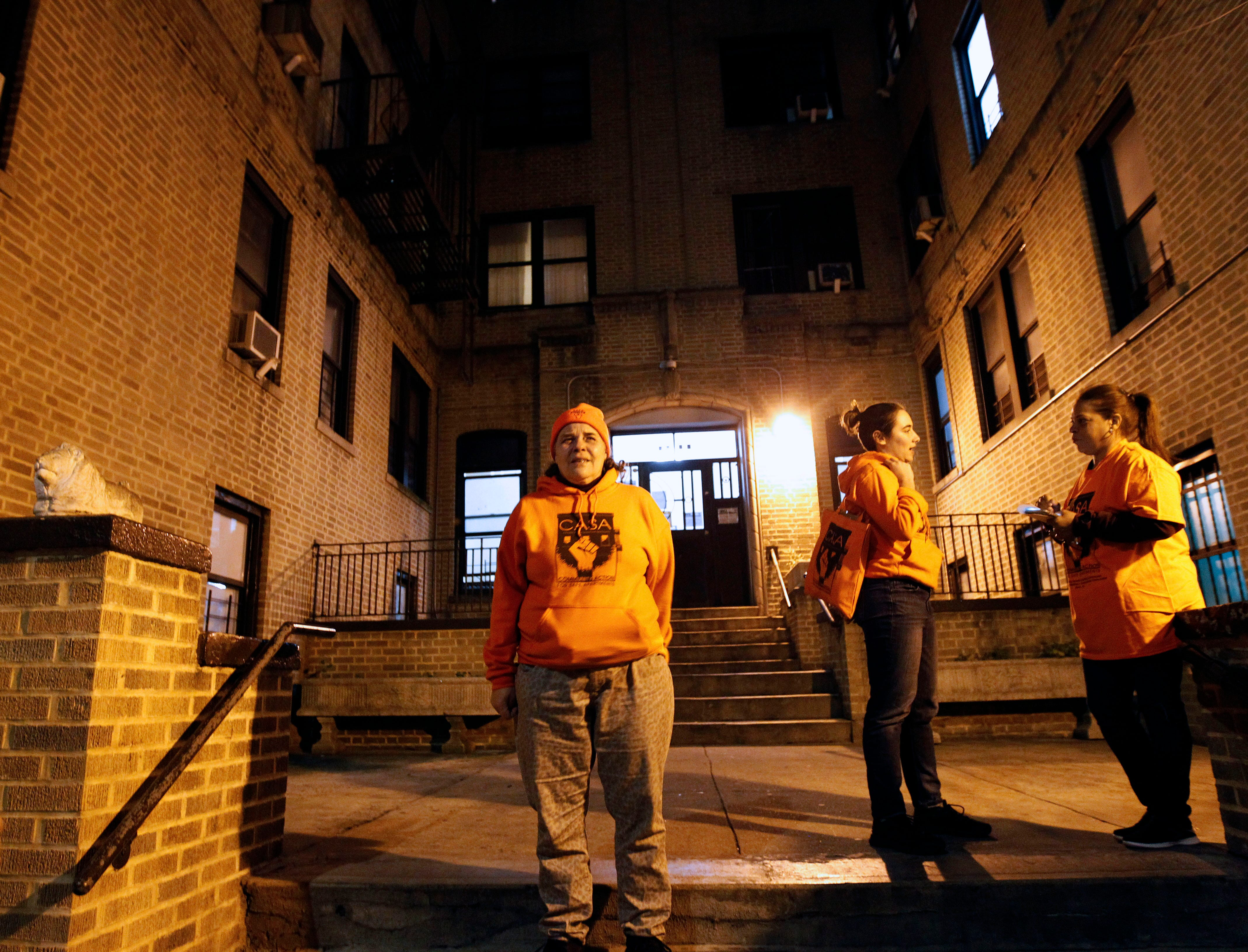Kim Statuto, left, stands outside her Bronx apartment in October 2019 following a protest that she organized for the tenants in her building to bring attention to the fact that they have been without gas for over a year.