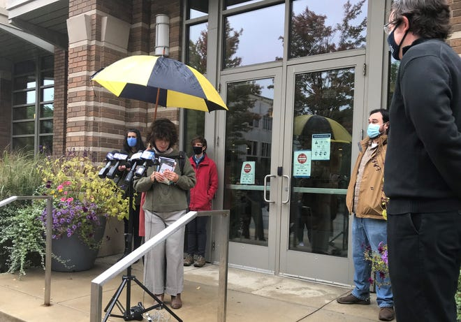 Marquette University graduate students and faculty speak at a news conference Thursday in which they opposed the university's plan to potentially cut hundreds of jobs.
