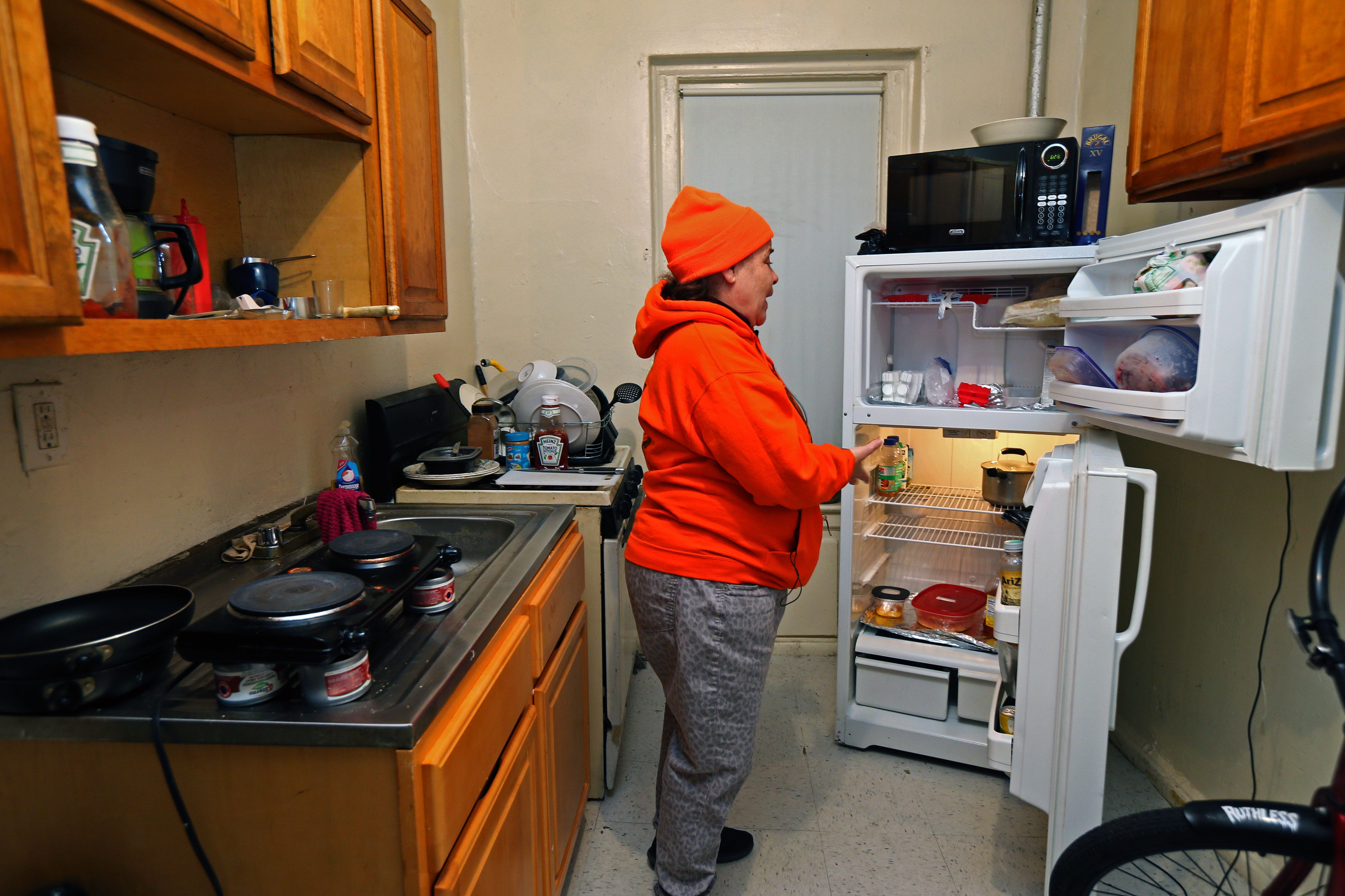 Kim Statuto, 59, keeps a small supply of  food in her refrigerator because she is unable to fully prepare meals at her Bronx apartment. Statuto, a resident for 26 years at the Bronx tenement, said she cooks at her daughter's apartment most days.