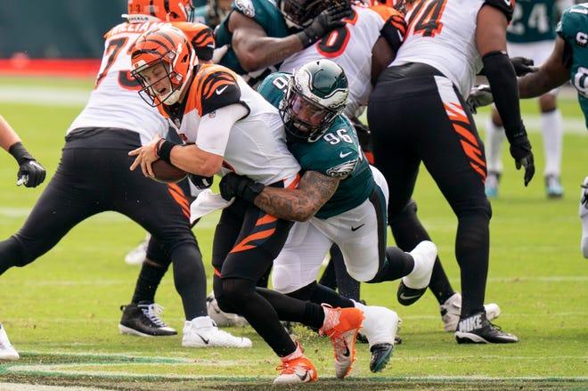Cincinnati Bengals quarterback Joe Burrow (9) gets sacked by Philadelphia Eagles defensive end Derek Barnett (96) on Sept. 27, 2020.
