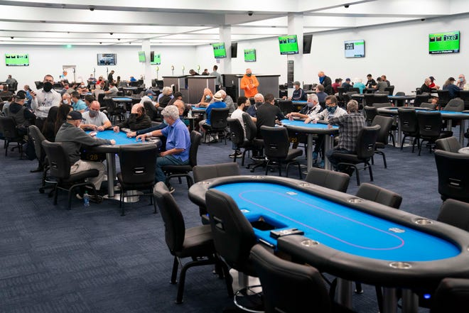 Visitors gamble in the 37-table live poker room at the Bonita Springs Poker Room on Wednesday, Sept. 30, 2020. The new facility, which opened to the public last fall, features live poker, simulcasting, and a Brass Tap restaurant.