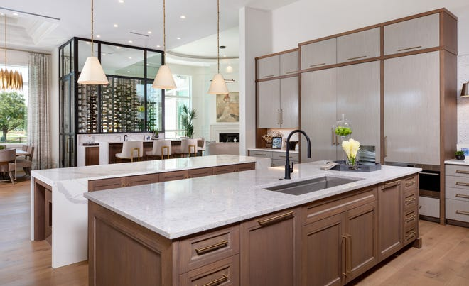 Stock Custom Homes' Newport model in Quail West features two island counters in the kitchen.