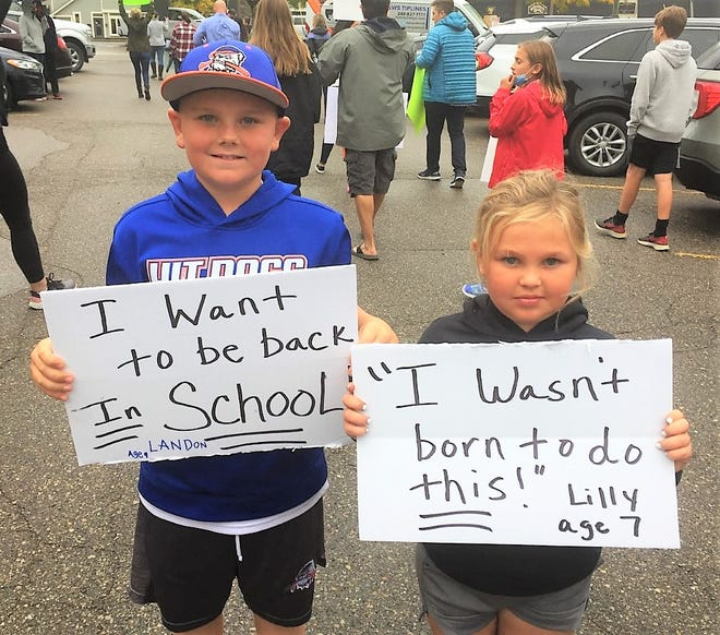 Landon and Lilly Caputo will have to wait until at least Friday to learn if they'll be returning to school for half days beginning in October.