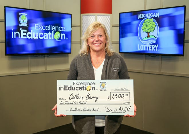 Plymouth-Canton Community Schools Colleen Berry was awarded a check for $1,500 by the Michigan Lottery.