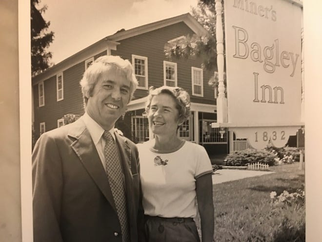 Dick and Nancy Miner share their delight in their restoration of the Bagley Inn on Long Lake Road. It was built in 1833, and it served as a coach stop on the route from Detroit to Pontiac on the Saginaw Trail, now known as Woodward Avenue. It was declared a Michigan historic site. The Miners placed their popular women's clothing store there.