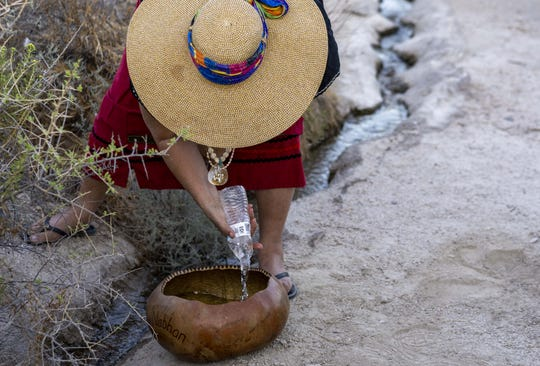 Eleanor Ortega, gets a water from Quitobaquito Springs during a ritual ceremony by Tohono and Hia-Ced O'odham organized a cross-border prayer run and ceremony to reaffirm religious and cultural practices along the Arizona-Mexico border. For tribal nations along the U.S.-Mexico border, such as the Hia-Ced and Tohono O'odham, the construction of these border barriers threatens to further sever their members living on the Mexican side from the tribal communities, rituals and services in the United States. And along the way, they argue, the construction is imperiling sacred sites, like Quitobaquito Springs, that have been a part of the lives of tribal members on either side of the border, before there even was a border.