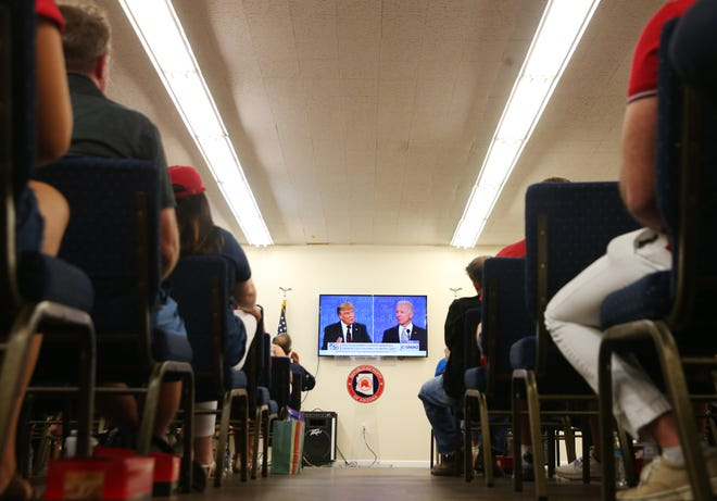 Republican supporters watch the presidential debate during a watch party at the Republican Party of Arizona headquarters in Phoenix Sept. 29, 2020.