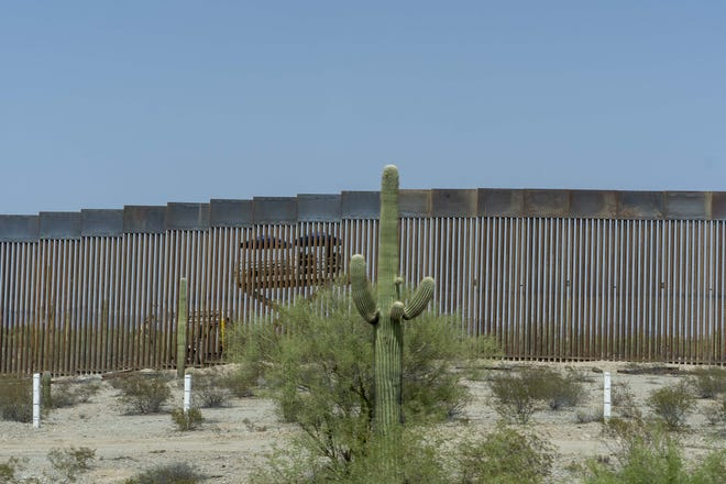 The construction site is seen from the Mexican side of the border. President Trump is building a 30-foot wall construction Organ Pipe Cactus National Monument in southern Arizona is sacred land for natives, and building a wall will ruin land and wildlife preservation.