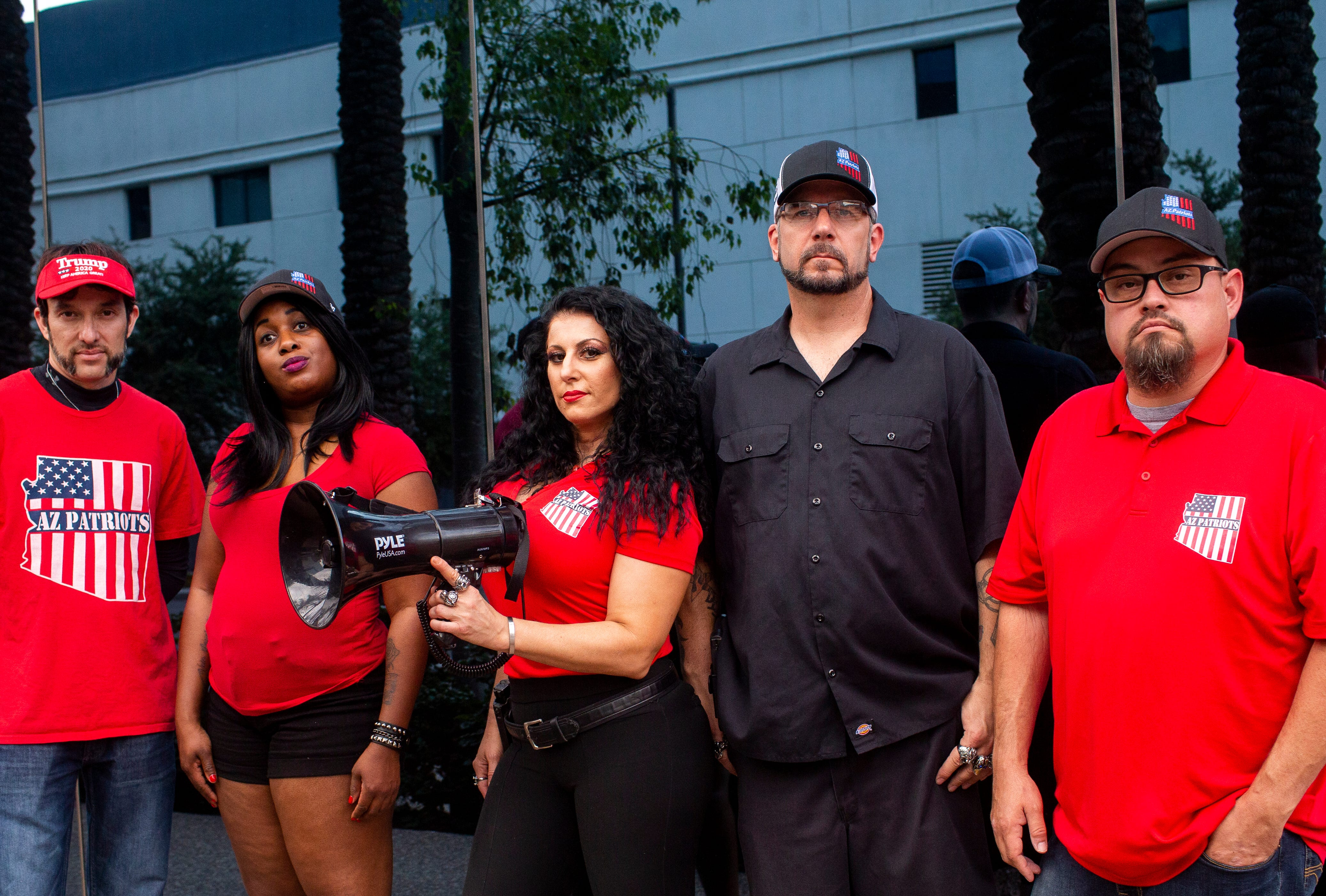 From left to right: AZ Patriots members Eduardo Jaime, Hope Coleman, Jennifer Harrison, Michael Pavlock and Jeremy Bronaugh pose for a portrait in front of The Arizona Republic in Phoenix on June. 24, 2020.