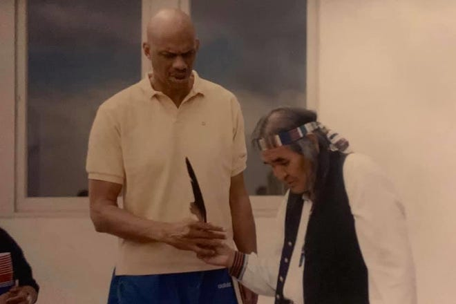A photo of White Mountain Apache Tribe member Edgar Perry with former professional basketball player, Kareem Abdul-Jabbar.