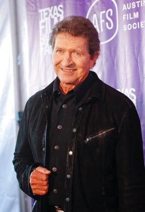 "FILE - Musician Mac Davis appears at the Texas Film Awards in Austin, Texas on March 6, 2014. Davis, a country star and Elvis songwriter,   died on Tuesday, Sept. 29, 2020 after heart surgery. He was 78. Davis started his career writing hits for Presley, including ""A Little Less Conversation"" and ""In the Ghetto."" The Lubbock, Texas-native had a varied career over the years as a singer, actor and TV host and was inducted into the Songwriters Hall of Fame in 2006. He was named ACM entertainer of the year in 1974 after the success of songs like ""Baby Don't Get Hooked on Me."" (Photo by Jack Plunkett/Invision/AP, File)"