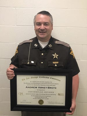 Capt. Andy Abney-Brotz, commander of the Wayne County Jail, recently received the national designation of certified jail manager.