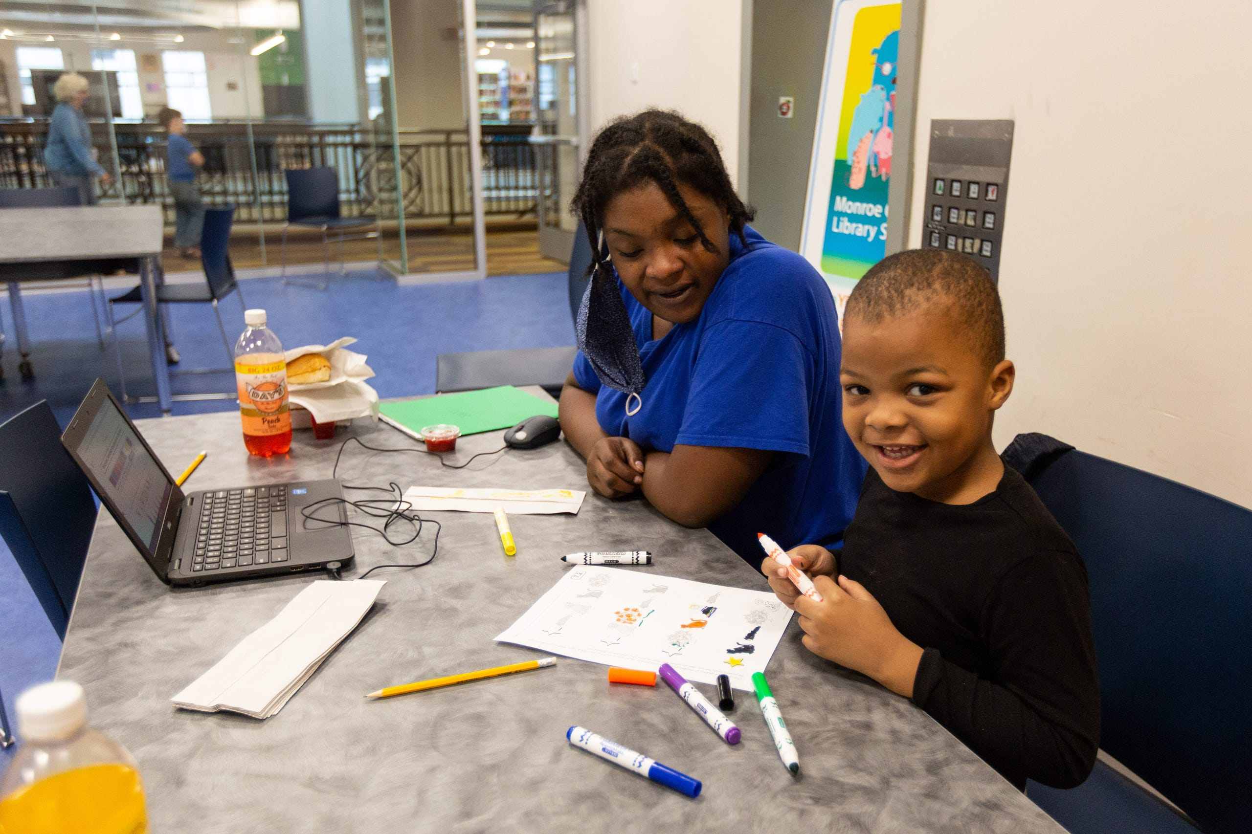 Trachelle Bivins and her 5-year-old son, Ondrae Florence, complete his school work together at Central Library of Rochester on Tuesday, Sept. 29, 2020. Ondrae and his mom have internet at home, but choose to come to the library because it creates a better learning environment for him.