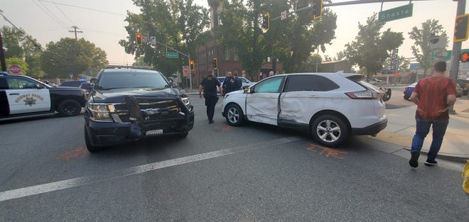 A white Ford SUV and CHP vehicle were involved in a collision in downtown Redding on Wednesday, Sept. 30, 2020.