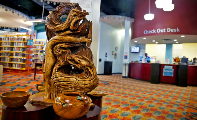 A sculpture made from the Bois-D'arc tree which stood near the Tom Green County Courthouse until destroyed by a 2019 storm sits in the Stephens Central Library on Wednesday, Sept. 30, 2020.