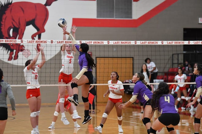 Sonora High School's Skylar Harris (5) goes up for a block against a Crane attacker during a District 5-3A volleyball match Tuesday, Sept. 29, 2020, in Sonora.