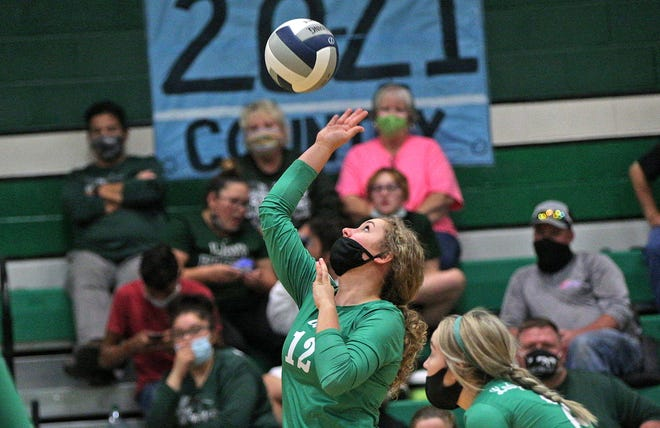 Caroline Holtman, left, spikes the ball for Wall during a game against Grape Creek on Tuesday, Sept. 29, 2020.