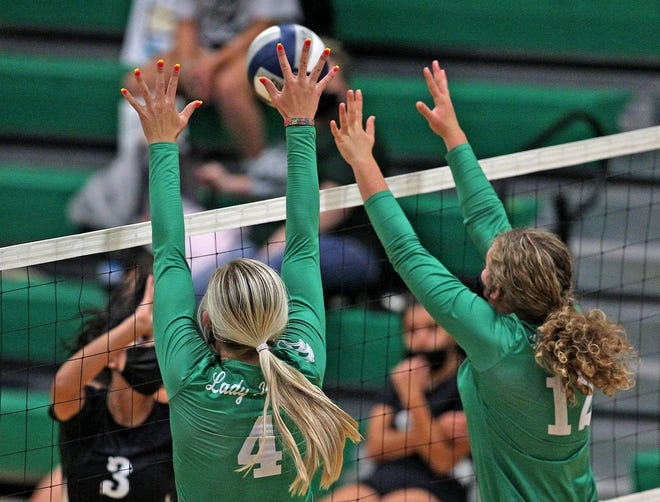 Kamryn Williams, left, and Caroline Holtman, right, try to block a shot for Wall during a match against Grape Creek on Tuesday, Sept. 29, 2020.