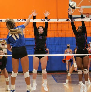San Angelo Central's Ashton McMillan, center, and Kameryn Daniels try to block an attack by Frenship's Gracie Harrison in the District 2-6A volleyball opener at Babe Didrikson Gym on Tuesday, Sept. 29, 2020.
