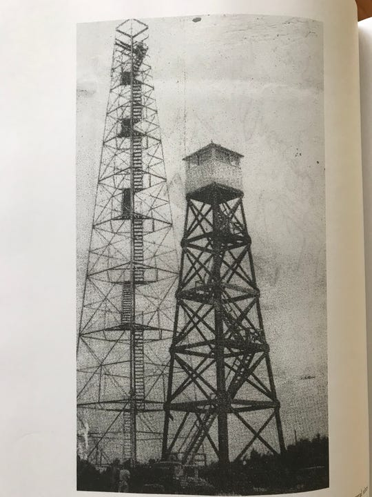Missouri's tallest fire tower was this 120-footer steel tower near Goodman, seen here under construction to replace the wooden tower to its right.
