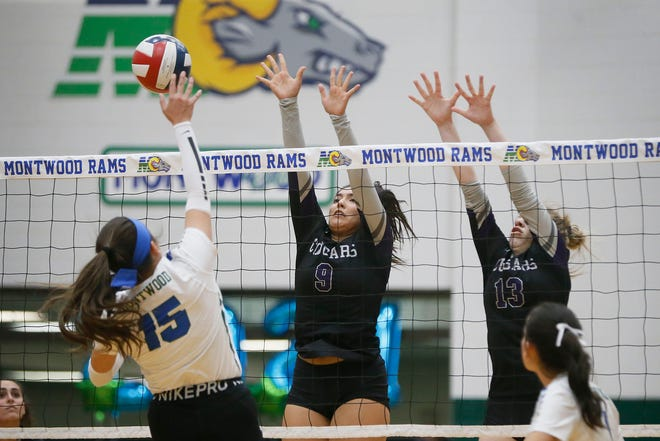 Montwood's Samantha Sierra (15) goes against Franklin's Isabella Molina (9) and Victoria Briones (13) in the 1-6A opener Tuesday, Sept. 29, at Montwood High School in El Paso.