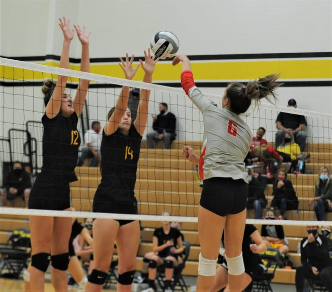 Sheridan's Abby Dupler hits the ball against Tri-Valley's Reece Smalley (12) and Abby Stanford (19) in Tuesday's match.