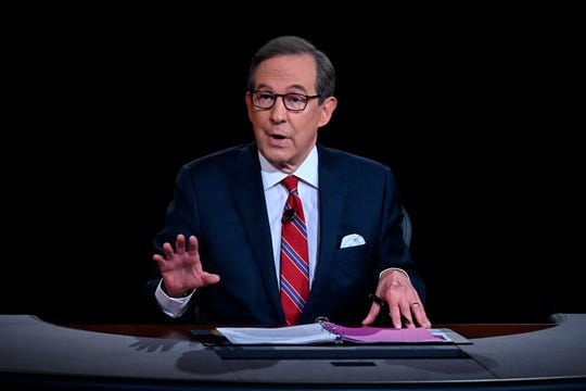 Chris Wallace of Fox News moderates the first presidential debate between President Donald Trump and Democratic candidate Joe Biden on Sept. 29 in Cleveland.