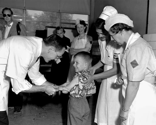 Dr. Richard J. Mulvaney gives injection to Randy Kerr, Polio Pioneer No. 1, on April 26, 1954, in McLean, Virginia.