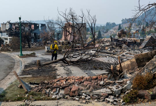 Deputy Fire Marshal Cliff DuGranruth examined the debris left by the Glass Fire in Santa Rosa, California, on September 29, 2020.