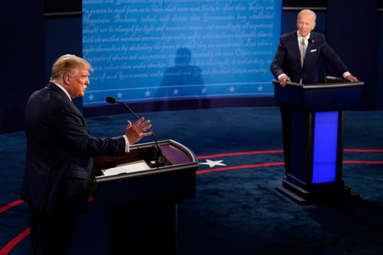 President Donald Trump answers a question as Democratic presidential candidate former Vice President Joe Biden listens during the first presidential debate Tuesday, Sept. 29, 2020, at Case Western University and Cleveland Clinic, in Cleveland, Ohio. (AP Photo/Morry Gash, Pool)