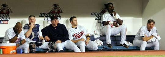 Minnesota Twins players, from left, Torii Hunter, Michael Restovich, Matthew LeCroy, Lew Ford, Cristian Guzman and Terry Mulholland had no idea their loss in the 2004 AL Division Series would lead to a record-breaking playoff losing streak.