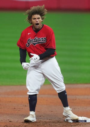 Cleveland Indians left fielder Josh Naylor (31) celebrates at second base after hitting a 2 RBI double during the first inning of Game 2 of the American League Wild Card Series against the New York Yankees, Wednesday, Sept. 30, 2020, in Cleveland, Ohio. [Jeff Lange/Beacon Journal]
