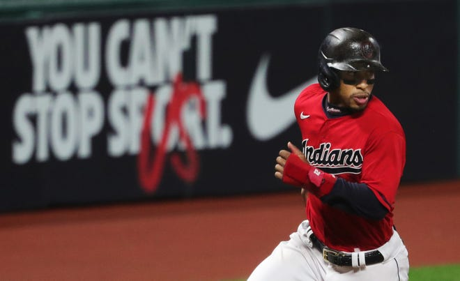 Indians shortstop Francisco Lindor (12) rounds third on his way to home plate during the fifth inning of Game 2 of the American League Wild Card Series. [Jeff Lange/Beacon Journal]