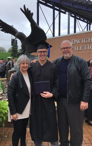Ronnie Hopkins at the Ashland University commencement with his aunt and uncle in May 2019.