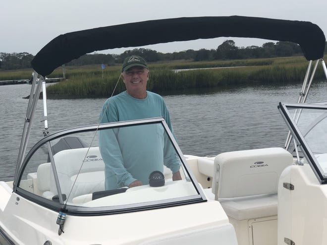 Rich Panettieri of Doylestown Township, a member of the Freedom Boat Club, prepares to take a new, 22-foot Cobia boat for a ride in a back bay at Cape May, New Jersey.