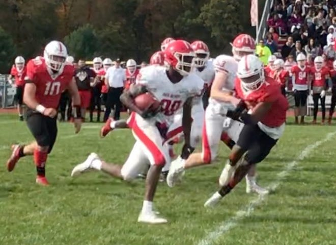 Rancocas Valley's Maurice Obanor (38) gets loose for a long touchdown in last season's meeting with Lenape High School