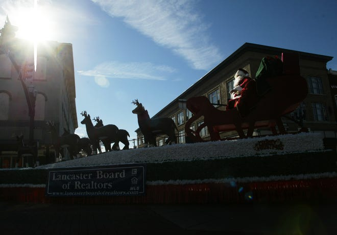 Santa Claus rides in the final float of the Holiday Festival Parade through Lancaster on November 19, 2005.
