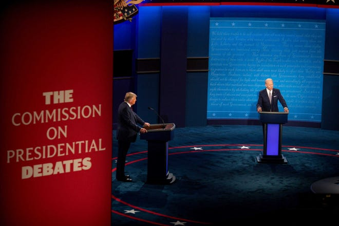 President Donald Trump and former Vice President Joe Biden appear in the first presidential debate in the Sheila and Eric Samson Pavilion at the Cleveland Clinic, Tuesday, Sept. 29, 2020, in Cleveland.
